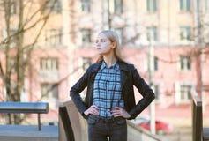 Stylish girl rocker posing in the city Stock Photo