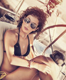 Stylish girl on sailboat Royalty Free Stock Photos