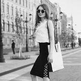 Stylish girl with shopping bag Royalty Free Stock Photography