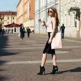 Stylish girl with shopping bag Stock Photo
