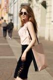 Stylish girl with shopping bag Royalty Free Stock Image
