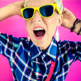 Girl  shouts on a bright background Royalty Free Stock Images