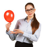 Girl shows up on the red ball Stock Images