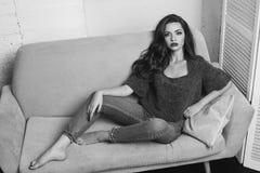 Stylish girl sitting at sofa Stock Images