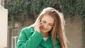 Stylish girl speaking on the phone and smiling stock footage