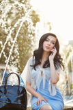 Stylish girl speaks by phone. Stock Photos