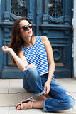 Stylish girl standing on the old door background royalty free stock photos