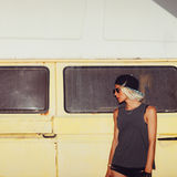 Stylish girl stands near minibus. Surf fashion style Royalty Free Stock Photo