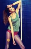 Stylish girl in stockings posing outside Stock Image