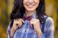 Stylish girl straightens bow tie Stock Photos