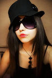 stylish girl in sunglasses and and hat Royalty Free Stock Photos
