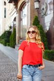 Stylish girl in sunglasses on a street walk. Street style portrait. Young girl on a street walk. Street style portrait. Beautiful girl in the city. Stylish girl royalty free stock photography