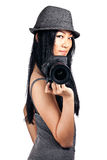 Stylish girl taking a photo. A young asian girl getting ready to take a photo with an SLR camera Stock Image