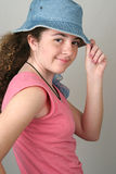 Stylish Girl Tips Hat Stock Photo