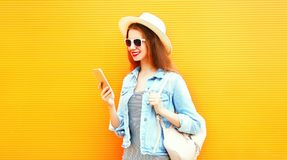 Stylish girl is using the smartphone in the city Royalty Free Stock Photo