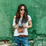 Stylish girl with vintage film camera Royalty Free Stock Images