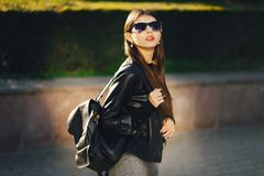 Stylish girl walking through the city royalty free stock images