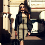 Stylish girl walking in city Royalty Free Stock Images