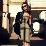 Stylish girl walking in city Royalty Free Stock Photo