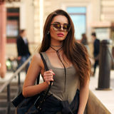 Stylish girl walking in city Stock Photography