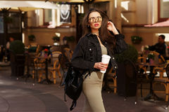 Stylish girl walking in city Royalty Free Stock Photography