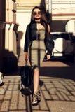 Stylish girl walking in city Stock Photos
