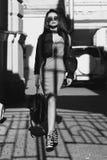Stylish girl walking in city Stock Photography