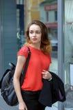 Stylish girl walking down the street Stock Photo
