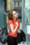 Stylish girl walking down the street Stock Image