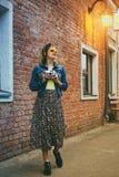 Stylish girl walking with vintage camera Royalty Free Stock Photo