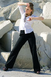Stylish girl wearing pants and a shirt Royalty Free Stock Photos