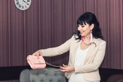 Stylish girl in white dress and pink jacket with handmade pink earrings and knitted bag. Stylish girl in white dress and pink jacket with handmade pink earrings Royalty Free Stock Photo