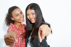Stylish girls posing at the camera Royalty Free Stock Photography
