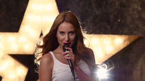 Stylish Glamour girl with a microphone, closed stock footage