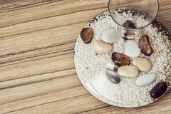 Stylish glass vase full of decorative stones, indoor decoration Royalty Free Stock Image