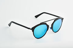 Stylish glasses with blue tinted mirror Stock Photos