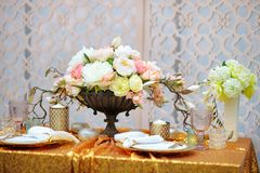 Stylish golden table set Stock Photo