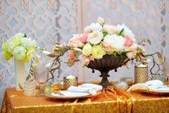 Stylish golden table set Royalty Free Stock Photo