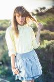 Stylish gorgeous blonde on the roadside posing Stock Image