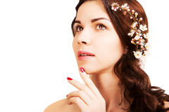 Stylish gorgeous brown haired woman with blooming branch isolate Royalty Free Stock Images
