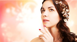Stylish gorgeous brown haired woman with blooming branch, pink b Royalty Free Stock Images