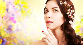 Stylish gorgeous brown haired woman with blooming branch, summer Royalty Free Stock Images