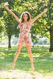 Stylish gorgeous brunette jumping in the air Royalty Free Stock Photos