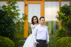 Stylish gorgeous happy brunette bride and elegant groom on the b Stock Image