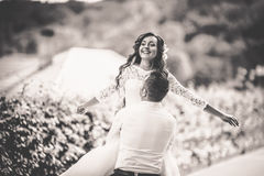Stylish gorgeous happy brunette bride and elegant groom walking Stock Images