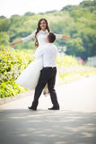 Stylish gorgeous happy brunette bride and elegant groom walking Royalty Free Stock Photo