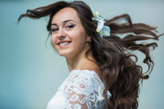 stylish gorgeous happy brunette bride with orchids on the background of a lake stock photography