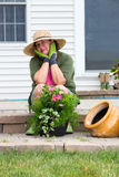 Stylish Grandma in gumboots and sunhat Royalty Free Stock Images