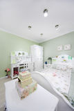 Stylish green bedroom with big bed Royalty Free Stock Photo