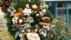 Stylish green Christmas wreath of holly, fir branches, anise, dried orange and others are sold at Christmas market. Stylish green Christmas wreath of holly, fir stock video